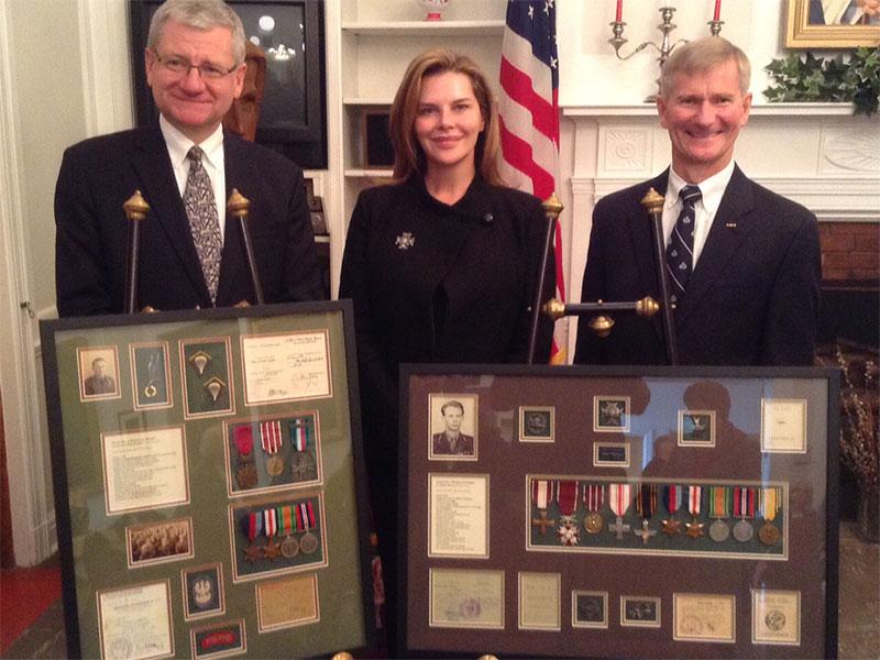 Ambassador Winid, Ms. John and Director Kochan with displays of Julian Kurtz and Jakub Kochan